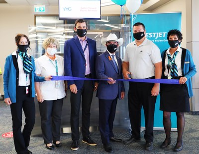 YYC-YYG inaugural event ribbon cutting (CNW Group/WESTJET, an Alberta Partnership)
