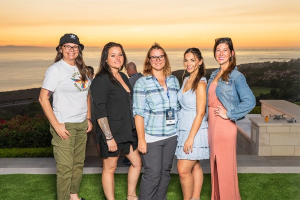 (from left) Veterans Samantha Simonds, Vanessa Brown, Robin Baker and Mea Peterson are joined by Freedom Alliance Scholar Haley Nicole Taylor (second from right). Taylor, currently pursuing her Master's degree in Communications, Media & Theatre, sang the National Anthem as part of the tournament's opening ceremonies.